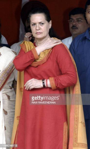 Indian opposition leader and Congress President Sonia Gandhi attends the flag-off ceremony of 50 trucks carring 450,000 kilograms of wheat for...