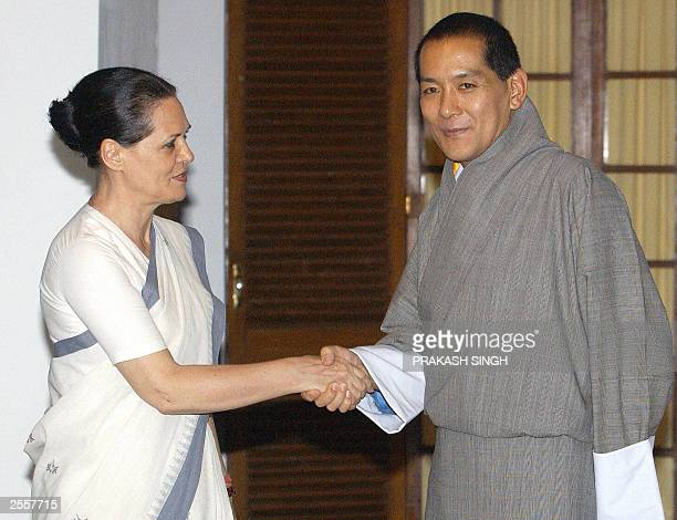 Indian Opposition Leader Sonia Gandhi shakes hands with King of Bhutan Jigme Singye Wangchuck before a meeting in New Delhi 17 September 2003...