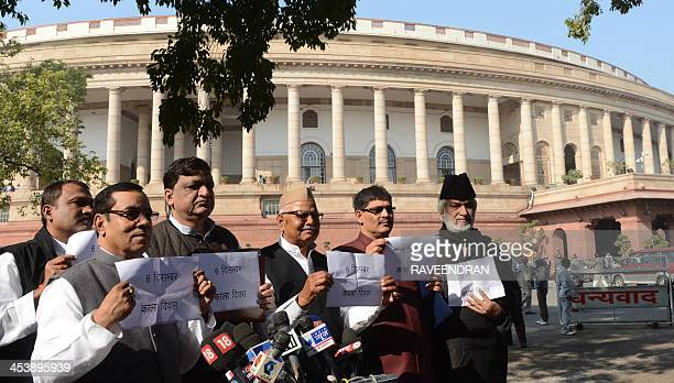 Indian opposition party members of parliament hold placards during a protest to mark the 21st anniversary of the demolition of the 16th century Babri...