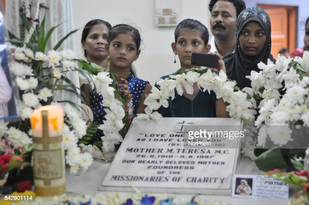 Indian orphanage Children's pray at the tomb of Mother Teresa at a service to commemorate the 20th death anniversary of Mother Teresa at the...