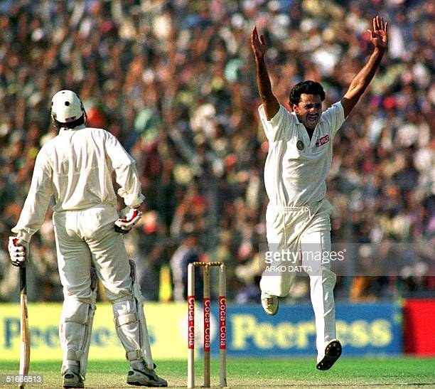 Indian pace bowler Javagal Srinath celebrates after trapping Pakistani batsman Salim Malik leg before wicket on the third day of the inaugural match...