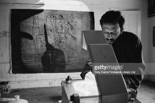 Indian painter Francis Newton Souza using an overhead projector in a studio circa 1965