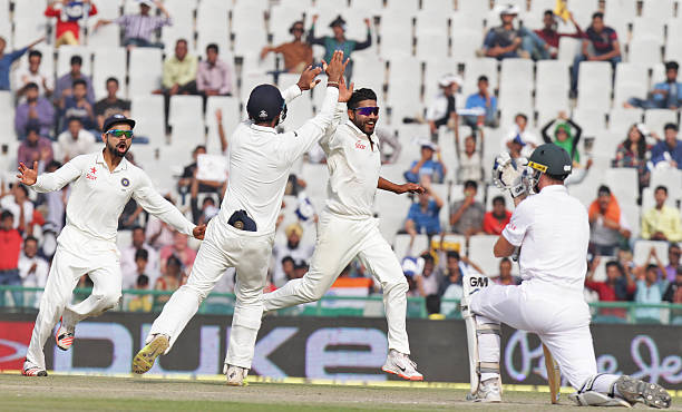 Indian palyer Ravindra Jadeja celebrating with team players after the dismissal of South African player Dean Vilas during the third day of first Test.