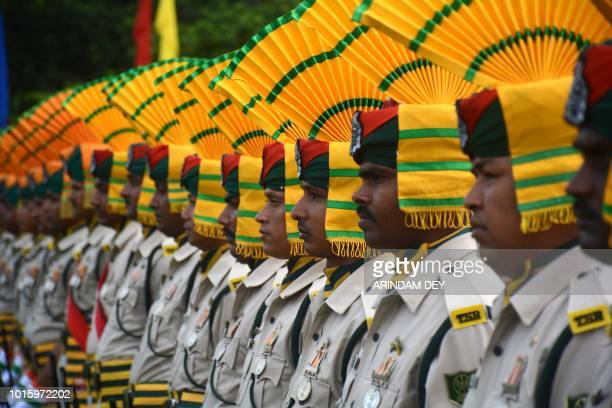 Indian paramilitary force personnel march pasts during the final dress rehearsal ahead of Independence Day celebration in Agartala the capital of...