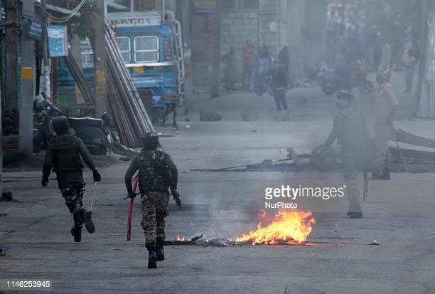 Indian paramilitary forces chase away pro freedom protesters in SrinagarKashmir on May 25 2019Anti India clashes erupt in many area of Srinagar soon...