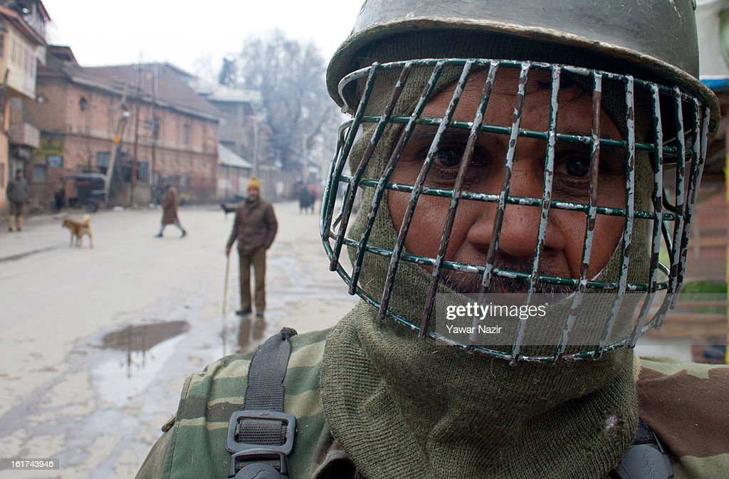 Indian paramilitary forces stand guard during a strict curfew on the seventh consecutive day, imposed after the execution of alleged Indian parliament attacker Mohammad Afzal Guru on February 15, 2013 in Srinagar, the summer capital of Indian Administered Kashmir, India. Afzal Guru, from Sopore town in the north of Kashmir, was hung on February 09 for his role in the 2001 Indian parliament attack which left 14 dead. The hanging has further strained relations between India - who blamed the attack on 'Pakistan backed' militant group Jaish-e-Mohammed - and neighbouring Pakistan and has seen an military increase from both along the border.Curfew was lifted from some parts of Srinagar after four days.