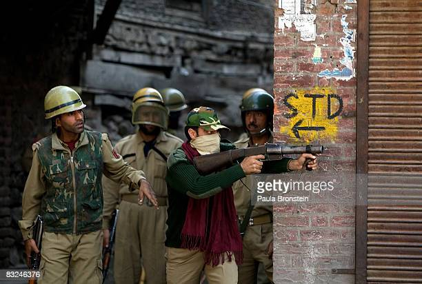 Indian paramilitary forces watch rock throwing youths on October 13 2008 in Srinagar KashmirIndia In the past few months the region's summer capital...