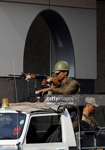 Indian paramilitary officials stand guard at the Indira Gandhi International Airport in New Delhi on December 4 2008 Security has been beefed up at...