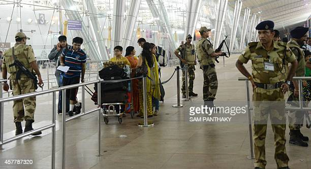 A Indian paramilitary soldiers from the Central Industrial Security Force keep vigil at the Sardar Vallabhbhai Patel International airport in...