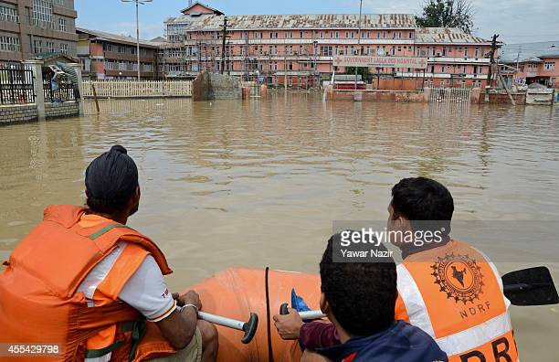 Indian paramilitary soldiers from the rescue wing row their boat in front the submerged Lal Ded hospital the only government maternity hospital in...
