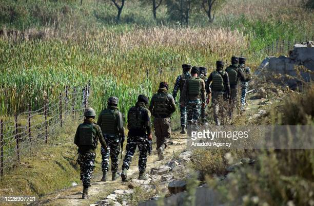 Indian paramilitary soldiers inspect and move towards the spot on the outskirts of Srinagar on October 05, 2020.Two Indian Central Reserve Police...