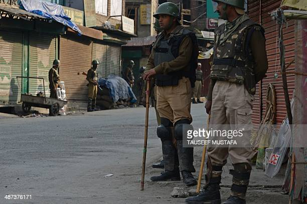 Indian paramilitary soldiers patrol as general election voting opened in old town Srinagar on April 30 2014 India's 814millionstrong electorate is...