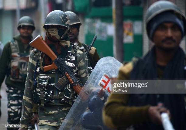 Indian paramilitary soldiers patrol near the closed market during the second phase of elections in Srinagar Kashmir on April 18 2019Indian general...