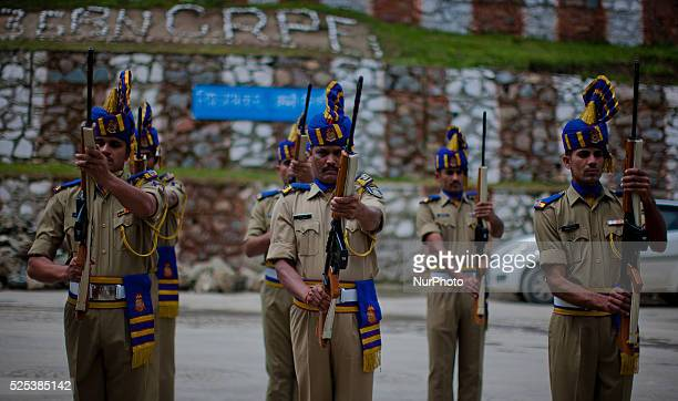 Indian paramilitary soldiers salute their killed comrade during a wreathlaying ceremony on May 12 2015 in Srinagar the summer capital of Indian...