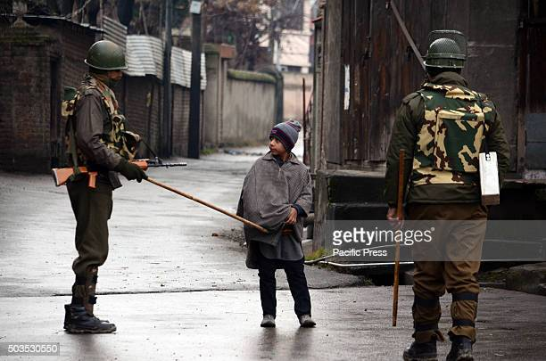 Indian paramilitary soldiers stop a Kashmiri Muslim kid in Saida Kadal area of Srinagar the summer capital of Indian controlled Kashmir Authorities...