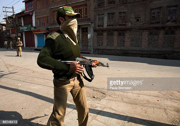 Indian paramilitary stands guard as he watches rock throwing youths on October 13 2008 in Srinagar Kashmir India In the past few months the region's...