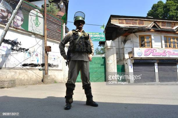 Indian paramilitary trooper stands guard during a curfew restrictions on the second death anniversary of Burhan Muzaffar Wani a young rebel commander...