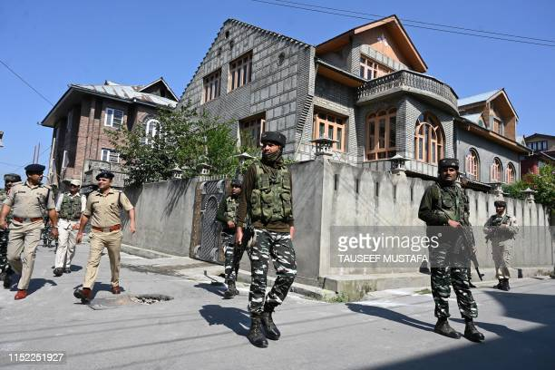Indian paramilitary troopers patrol along a street before before the arrival of Indian Union Home Minister Amit Shah to visit family members of slain...