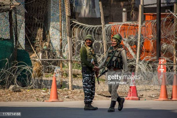 Indian paramilitary troopers shake greet each other outside his bunker in the city center, on September 24, 2019 in Srinagar, the summer capital of...