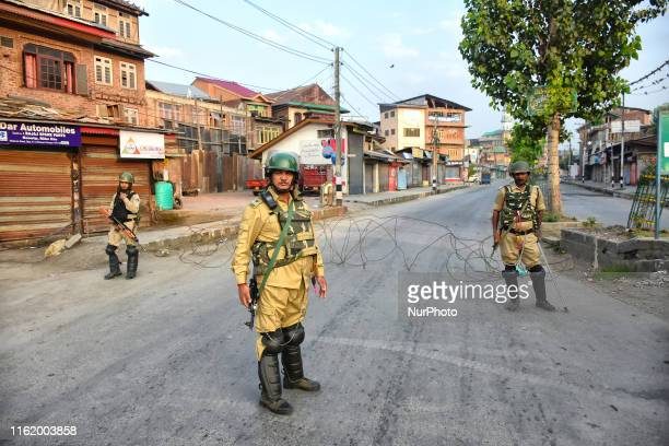 Indian paramilitary troopers stand alert during curfew in Srinagar Indian Administered Kashmir on 05 August 2019 Strict curfew was implemented in...