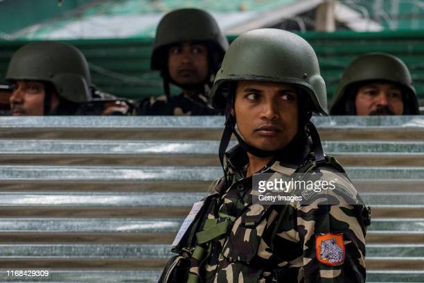 Indian paramilitary troopers stand alert outside the Sher i Kashmir stadium where the authorities held the main function during India's Independence...