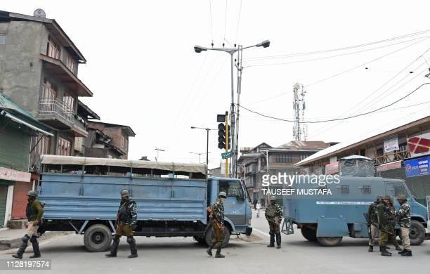 Indian paramilitary troopers stand guard as they block a road in Srinagar on March 1 2019 While Pakistan's promised release of an Indian pilot has...