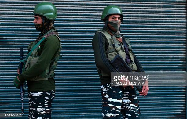 TOPSHOT Indian paramilitary troopers stand guard during a lockdown in Srinagar on October 27 2019 Kashmiri separatists observe October 27 as a black...