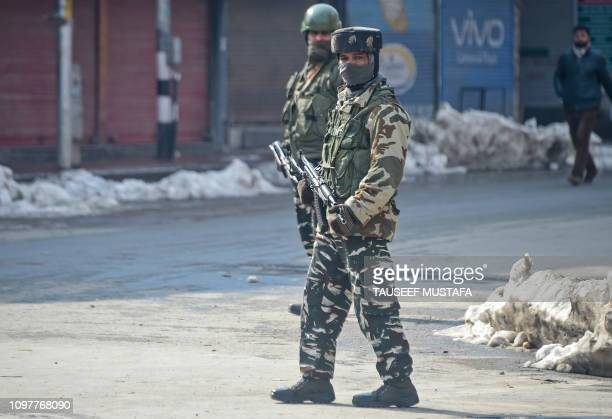 Indian paramilitary troopers stand guard during a oneday strike called by Kashmiri separatists to mark the death anniversary of Jammu and Kashmir...