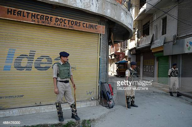 Indian paramilitary troopers stand guard during a oneday strike called by separatists in Srinagar on September 16 2015 The protest shutdown was...