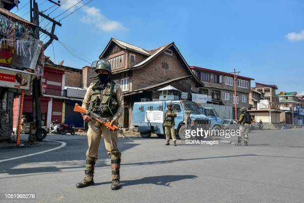 Indian paramilitary troopers stand guard during restrictions in Srinagar Indian administered Kashmir Authorities impose restrictions in Srinagar amid...