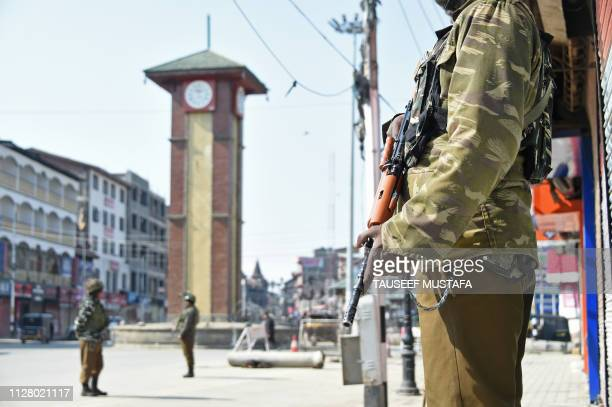 Indian paramilitary troopers stand guard during the second day of strike called by separatists against the National Investigation Agency raids at...