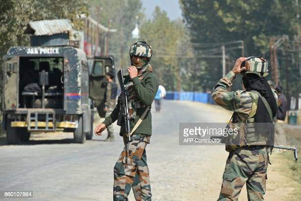 Indian paramilitary troopers stands guard after a gunfight with militants at Hajin village of Kashmir's Bandipora district north of Srinagar on...