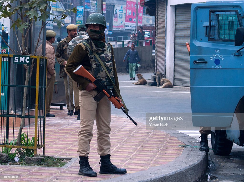 Indian paramilitary troopers stands guard during a shutdown against the landing of Indian army in Kashmir on October 27, 2013 in Srinagar, the summer capital of Indian administered Kashmir, India. A shutdown called by many resistance groups against the landing of the Indian army in Indian administered Kashmir on October 27, in 1947. Kashmir observes shut down on this day 'since the beginning of an armed rebellion' to protest the landing of Indian army in the mountainous region after the king of the former Independent princely state signed a conditional instrument of accession with the Indian union in 1947. The Indian army landed to quell an internal revolt aided by tribal warriors from Pakistan.