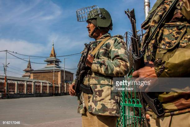 Indian paramilitary troopers stands guard in front Kashmir's Jamia Masjid in the Old City during restrictions on the fifth death anniversary of Afzal...