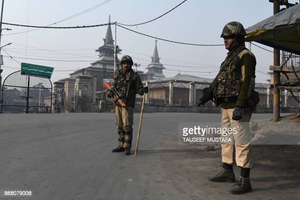 Indian paramilitary troopers stands guard near Jamia Masjid mosque during a restriction in Srinagar on December 8 2017 A partial restrictions have...