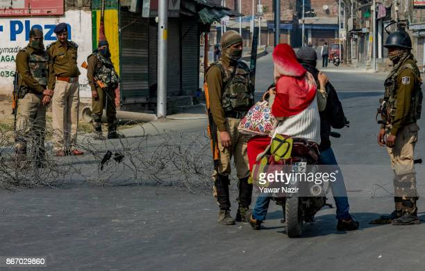 Indian paramilitary troopers stop a Kashmiri motorcyclist during a strike on October 27 2017 in Srinagar the summer capital of Indian administered...