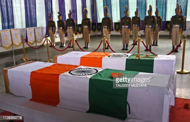 TOPSHOT Indian paramilitary troopers take part in the wreath laying ceremony of two slain paramilitary colleagues at the Central Reserve Police Force...