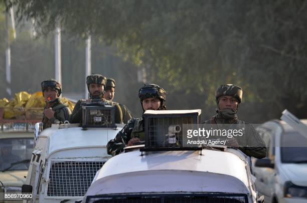 Indian paramilitary troops move towards the gun battle site in Humhama on the outskirts of Srinagar the summer capital of Indian controlled Kashmir...