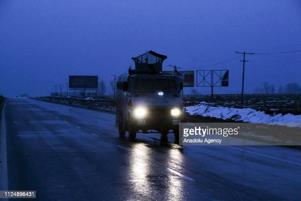 Indian paramilitary vehicle makes its way to the scene of attack in Lethpora area on the outskirts of Srinagar Kashmir India on February 14 2019 At...