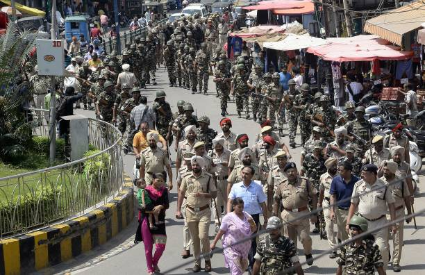 Indian paramiltary forces and police march in Jalandhar on August 26 2017 Security in Haryana and Punjab has been beefed up after followers of...