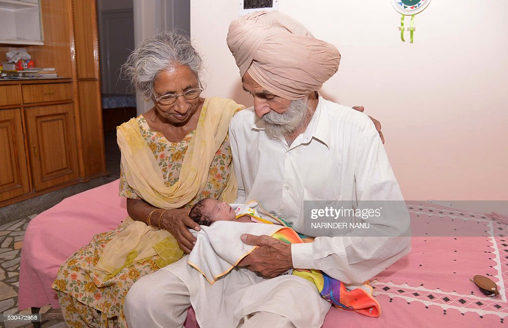 Indian parents Mohinder Singh Gill (R), 79, and Daljinder Kaur, 70, pose for a photograph as they hold their newborn baby boy Arman at their home in Amritsar on May 11, 2016. An Indian woman who gave birth at the age of 70 said May 10 she was not too old to become a first-time mother, adding that her life was now complete. Daljinder Kaur gave birth last month to a boy following two years of IVF treatment at a fertility clinic in the northern state of Haryana with her 79-year-old husband. NANU