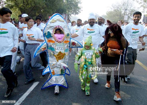 Indian participants run in costume during the Delhi Marathon 2006 in New Delhi 12 February 2006 Sports Management Group International organized the...
