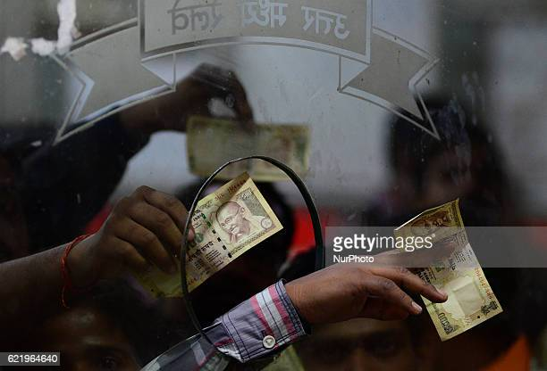 Indian passengers gather on a Railway ticket counter carrying 500 rupee notes to buy rail tickets in Allahabad Railway station on November 92016...