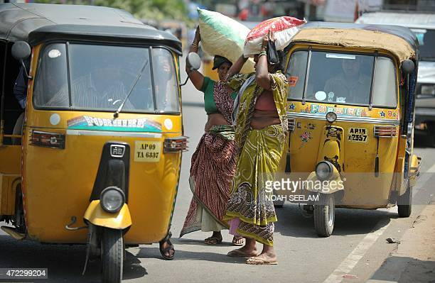 Indian passengers negotiate a fare with the driver of an autorickshaw in Hyderabad on May 6 during a strike called by Andhra Pradesh State Road...