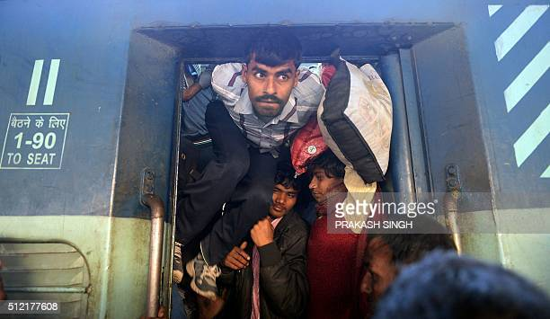TOPSHOT Indian passengers squeeze into the packed general wagon of The Simanchal Express at Anand Vihar Railway Station in New Delhi on February 25...