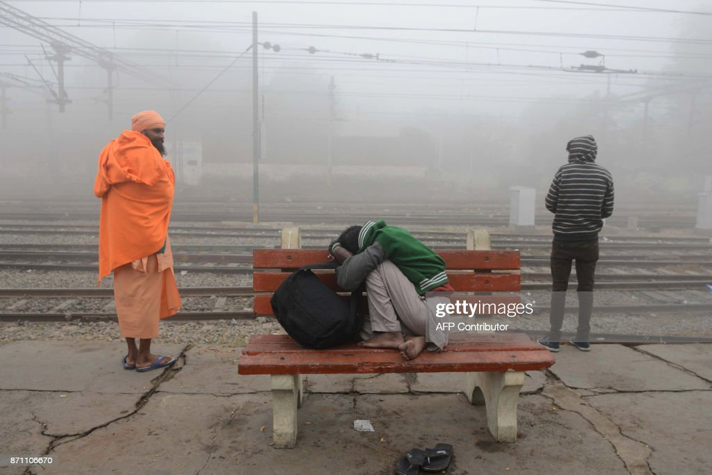 Indian passengers wait for a train amidst dense smog at a railway station in Amritsar on November 7 2017 India`s Central Pollution Control Board said.