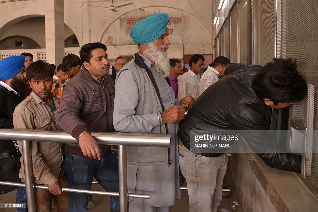 Indian passengers wait in line to purchase train tickets at a railway station in Amritsar on February 25 as the annual Railways Budget is announced...