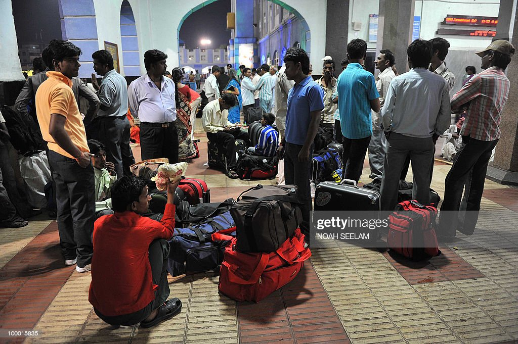 Indian passengers wait outside the Secunderabad Railway station after train cancellations in Hyderabad on May 20, 2010. A severe cyclone packing winds of 110 kilometres (70 miles) an hour hit India's southeast coast, forcing tens of thousands of people to evacuate their homes. Cyclone Laila slammed into the state of Andhra Pradesh about 50 kilometres southwest of the city of Machilipatnam, the Indian Meteorological Department (IMD) said. AFP PHOTO/Noah SEELAM