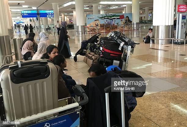 Indian passengers who said they were aboard the Emirati plane that caught fire the previous day during a crashlanding wait for their flight at the...