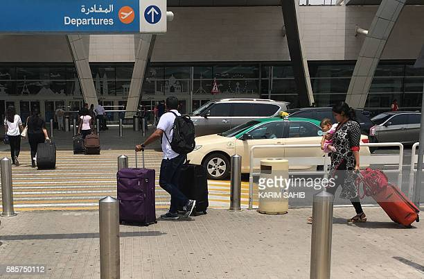 Indian passengers who said they were aboard the Emirati plane that caught fire the previous day during a crashlanding arrive at the departures hall...